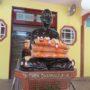 VenDhammasukha_Anniversary-Portrait of Ven Dhammasukha at the main entrance of the Memorial Hall