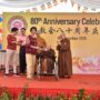80th_Anniversary -Representative of Singapore Buddhist Free Clinic receiving the cheque from Ven Bao Shi