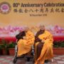 80th_Anniversary -Ven Bao Shi (President of The Buddhist Union) and Ven Bao Tong (Vice-President of The Buddhist Union) happily posing for a picture in front of the stage