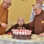 80th_Anniversary -Ven Bao Shi blowing the candles. Looking on is Ven Seck Kwang Phing and Ven Bao Tong