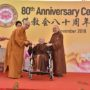 80th_Anniversary -Ven Bao Shi presenting a cheque to Ven Seck Kwang Phing in aid of the Singapore Buddhist Federation